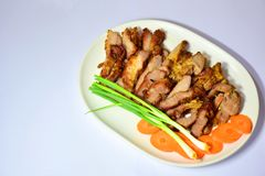Sliced pork - Sliced in a container. Spiced Pork Fry in boiling oil, rinse thoroughly, and rinse the skin. Slice the slices with the knife in a prepared serving Stock Image