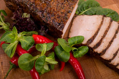 Sliced pork on a cutting board as seen from above Royalty Free Stock Photography