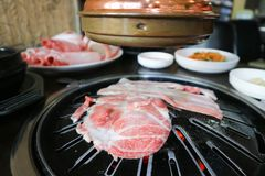 Pork on roaster. Sliced pork on the roaster stock photo