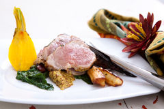 Sliced pork with spinach and parsnips Royalty Free Stock Photography