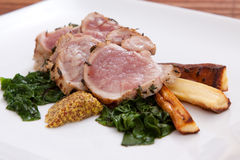 Sliced pork with spinach and parsnips Royalty Free Stock Photos