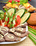 Sliced pork tongue with mayonnaise, sliced tomatoes, cucumbers, Stock Images