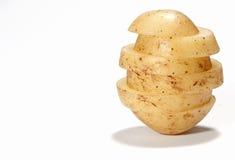 Sliced Potato. A sliced potato on a white background stock image