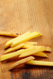 Sliced Potatoes. On a Cutting Board. Close up view Stock Photos