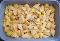 Sliced potatoes with italian Onion and rosemary ready to be baked stock photos