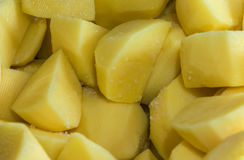 Sliced potatoes with salt. Pieces of sliced yellow raw potatoes with salt stock images