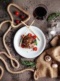 Sliced prime ribeye steak on black stone plate. royalty free stock photo