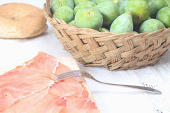 Sliced prosciutto crudo and figs Royalty Free Stock Photography