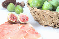 Sliced prosciutto crudo and figs Royalty Free Stock Image