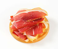 Sliced prosciutto crudo Stock Images