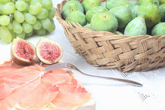 Sliced prosciutto and figs Royalty Free Stock Image
