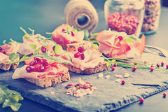 Sliced prosciutto with herbs and pomegranate seeds Royalty Free Stock Images