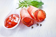 Sliced prosciutto in white wooden background Stock Image