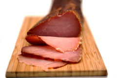 Sliced prosciutto on wooden board Stock Image