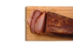 Sliced prosciutto on wooden board Stock Photo
