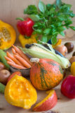 Sliced pumpkin and assorted vegetables Royalty Free Stock Photography
