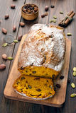 Sliced pumpkin bread loaf. With nuts, raisin and cinnamon Stock Photo