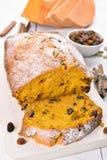 Sliced pumpkin bread loaf with nuts, raisin and cinnamon Stock Photos