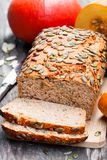 Sliced  pumpkin  bread  loaf on wooden cutting board with seeds Stock Photos