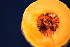 Sliced pumpkin with drops of juice, the core of the pumpkin stock photography