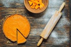 Sliced pumpkin pie on a table Stock Photo