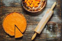Sliced pumpkin pie on a table Royalty Free Stock Images
