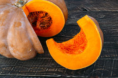 Sliced pumpkin on the table Stock Photos