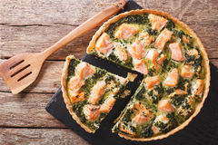 Sliced Quiche with salmon, spinach and cream close-up. horizonta Stock Photo