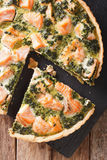 Sliced Quiche with salmon, spinach and cream close-up. vertical Stock Photography