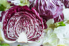 Sliced radicchio on table. Horisontal. Close-up. Sliced radicchio on table with green salad. Horisontal Royalty Free Stock Photo
