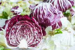 Sliced radicchio on table. Horisontal. Sliced radicchio on table with green salad. Horisontal Royalty Free Stock Images