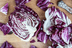 Sliced radicchio on wooden table. Selective focus. Close-up. Sliced radicchio on wooden background. Selective focus. Close-up Royalty Free Stock Images