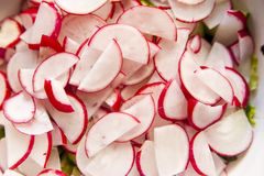 Sliced radish close-up. Radish, sliced for a salad close-up stock images