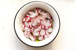 Sliced radish top view. Radish, sliced for a salad top view stock photo