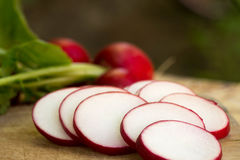 Sliced radish on wooden table. Closeup Royalty Free Stock Images