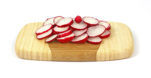 Sliced Radishes on Cutting Board. Colorful fresh sliced radishes on a small cutting board Stock Photos