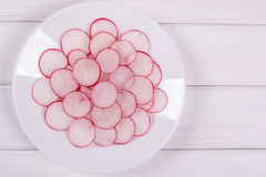 Sliced Radishes on white plate Royalty Free Stock Photo