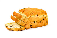 Sliced Raisin Bread on White Background. Sliced bread is a loaf of bread that has been sliced with a machine and packaged for convenience. It was first sold in Stock Photography