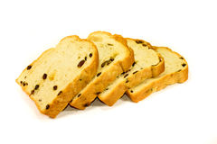 Sliced Raisin Bread on White Background. Sliced bread is a loaf of bread that has been sliced with a machine and packaged for convenience. It was first sold in Royalty Free Stock Images