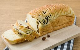 Sliced Raisin Bread on Wooden Cutting Board Royalty Free Stock Image