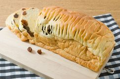 Sliced Raisin Bread on A Wooden Cutting Board Royalty Free Stock Image