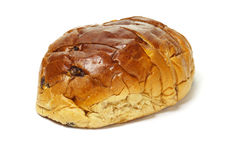 Sliced raisin bun. Loaf of sliced raisin bun on white background Stock Photos