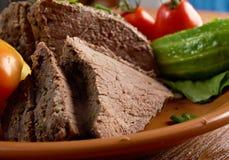 Sliced rare roast beef farm-style Royalty Free Stock Photos