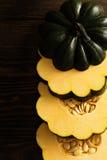 Sliced raw acorn squash on dark background Royalty Free Stock Images