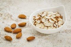 Sliced raw almonds Stock Photos