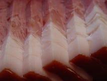 Sliced raw bacon. Macro background Stock Image