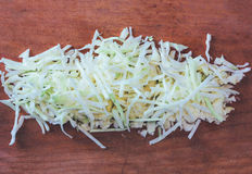 Sliced raw cabbage on an old cutting Board Royalty Free Stock Photos
