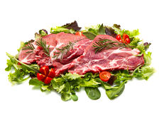 Sliced raw meat with salad Royalty Free Stock Photography