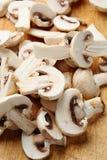 Sliced raw mushrooms close-up Stock Images