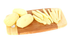 Sliced raw potatoes on a chopping board Stock Photos